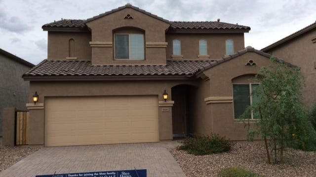 Shea Homes: A house awaits sale in San Tan Valley's Ridgeview at Johnson Ranch, where Shea Homes has cut prices by $17,000 on some existing models.