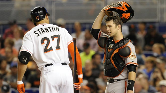 Giants catcher Buster Posey chats with Marlins outfielder Giancarlo Stanton. Both players are likely to be second-round picks in mixed leagues in 2014.