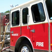 Firefighters are blaming ashes left in a plastic container for starting a fire in Lincoln County.