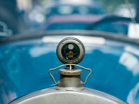The hood ornament of a 1927 Packard convertible.