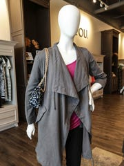 Carrigan BB Dakota Trench, $127.60, purse by Mode, $60, top by IGG, $68, jeans by DL 1961, Florence Cut, $158, from Profyle boutique.