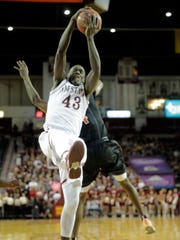 Pascal Siakam goes up for the rebound during the first half of action at the Pan American Center in Las Cruces, New Mexico against the NMSU Aggies. The Miners found themselves down at the end of the first half 36-28.