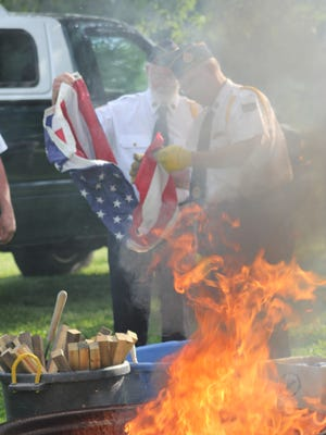 Flag retirement ceremony by the Oxford American Legion Tuesday, June 14, at Creekside Park, Oxford.