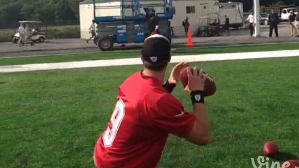 Drew Brees shoots skeet with footballs.