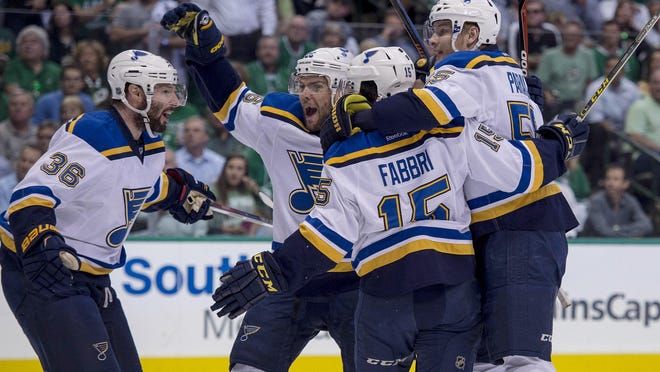 St. Louis Blues players celebrate a goal by Robby Fabbri (15) during the first period.