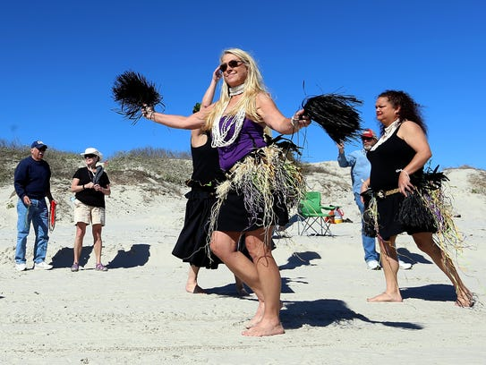 Dancers perform during the seventh annual Barefoot
