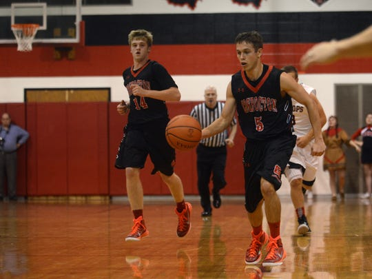 Coshocton's Jim Magness brings the ball up the floor against Rosecrans.