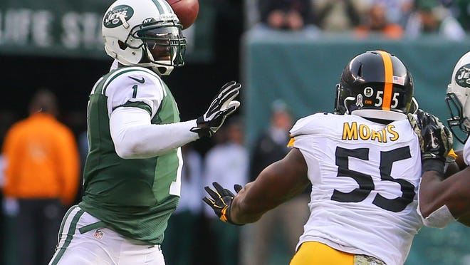 Nov 9, 2014; East Rutherford, NJ, USA; New York Jets quarterback Michael Vick (1) throws a pass while under pressure from Pittsburgh Steelers outside linebacker Arthur Moats (55) during the first half at MetLife Stadium. Mandatory Credit: Ed Mulholland-USA TODAY Sports