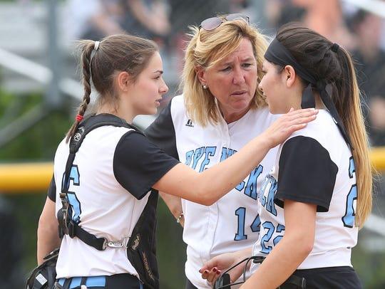 Rye Neck softball coach Joan Spedafino talks to players