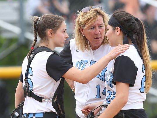 Rye Neck softball coach Joan Spedafino talks to players during the Section 1 Class B final against Valhalla at North Rockland High School. May 27, 2017.