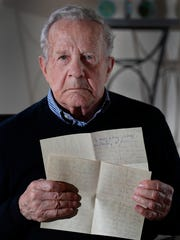 Frank Grunwald holds a copy of the letter his mother wrote to his father as she was being led to the gas chamber.