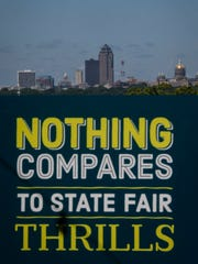 The Des Moines skyline sits behind a photo booth at the Iowa Craft Beer tent on Friday, August 11, 2017, during the Iowa State Fair in Des Moines.