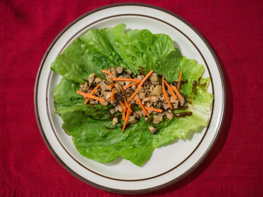 Lettuce wraps, featuring a chicken/mushroom/water chestnut stir-fry filling, plus hoisin sauce and carrots. Photo by Jeff Lautenberger.