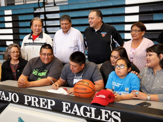 Navajo Prep's Tyler Pete signs his letter Friday to