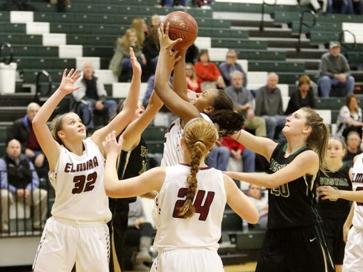 Action from the Elmira girls basketball team's 63-44
