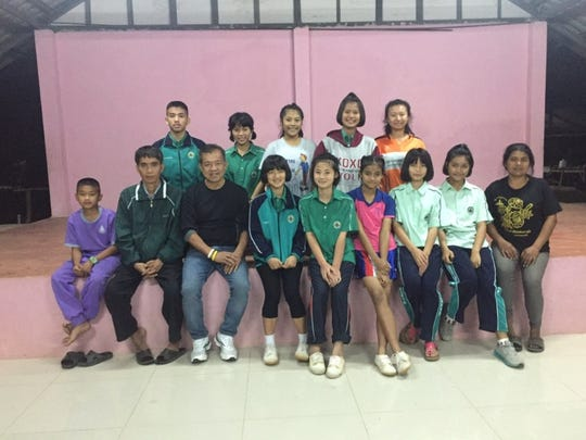 Springfield restaurant owner Tong Trithara poses with students and staff at a Thailand school. In 2015m Trithara founded a charity, Thailand Little Ones, to aid children in northern and central Thailand.