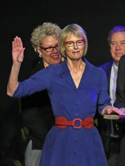 Suzanne Crouch is administered the oath to become Indiana lieutenant governor, by Chief Justice Loretta Rush, at the Indiana State Fairgrounds, Monday, Jan. 9, 2017.  Crouch's husband, Larry Downs, holds the Bible for the oath.