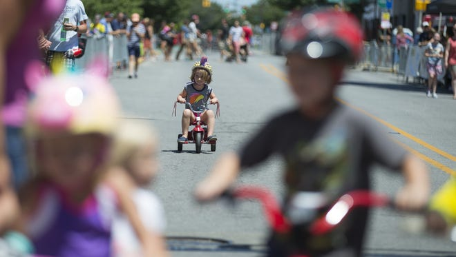 Vivi Mullins, 4, Indianapolis, heads down Mass Ave in last place during last year's 100 meter long race for little kids during the Mass Ave Criterium.