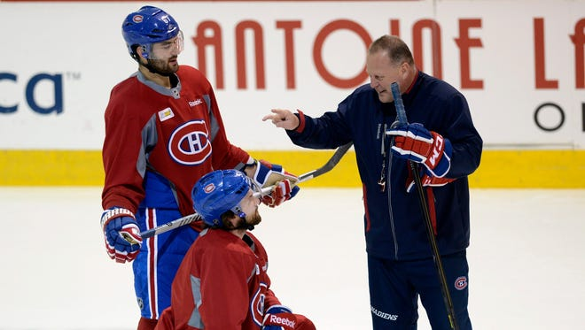 Montreal Canadiens assistant coach Gerard Gallant, right, speaks with Montreal Canadiens left wing Max Pacioretty, top, and center David Desharnais during the second round of the playoffs.