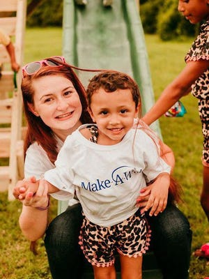 Make-A-Wish of Eastern North Carolina recently granted the wish of 2 ½-year-old Layah Collins from Jones County, who has cancer, to have a backyard playset. Her wish was revealed thanks to the Raleigh-based business Backyard Playground, the community, the Jones County Sheriff and fire department. She is pictured with her mom Alysha Collins.