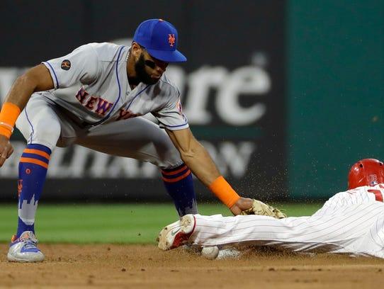 Philadelphia Phillies' Cesar Hernandez, right, steals