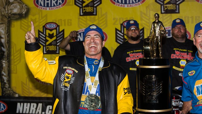 Ron Capps celebrates after clinching the 2016 NHRA Funny Car title at Auto Club Raceway.