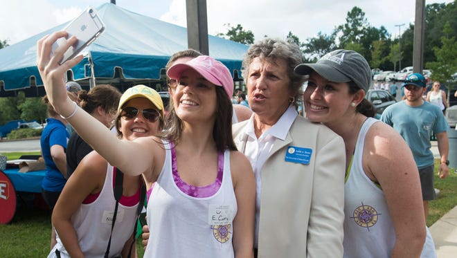 University of West Florida President Judy Bense, center, takes a few minutes to take a selfie with members of the Kappa Delta sorority during student move in day at the university Friday morning Aug. 19, 2016.
