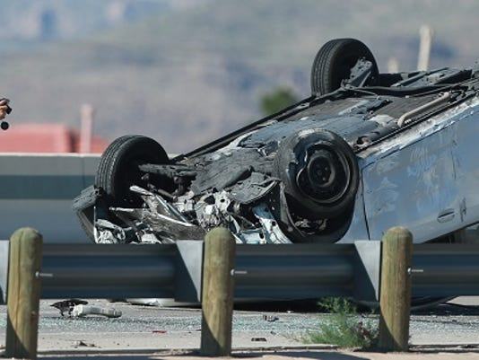 El Paso police gathered evidence at the scene of a rollover accident on U.S. 54 westbound near Kenworthy Wednesday morning.