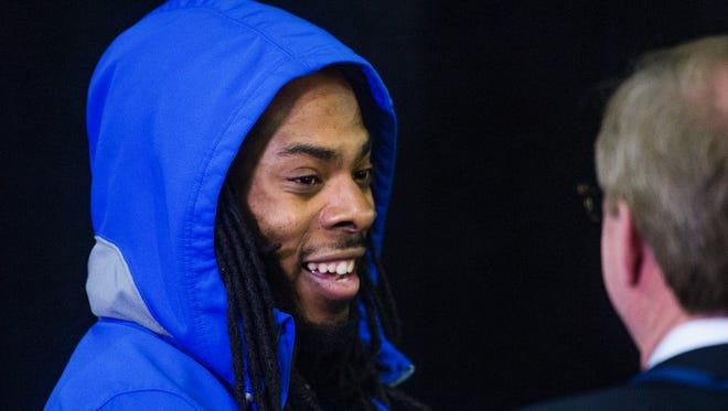Seattle Seahawks cornerback Richard Sherman answers questions from the media during a press conference at the Arizona Grand Resort after arriving from Seattle on Jan. 25, 2015.