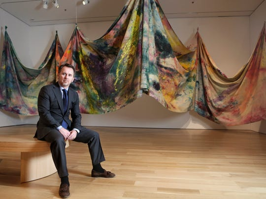 Ghislain d'Humières, the CEO of the Speed Art Museum, sits in front of a piece by Louisville native Sam Gilliam inside the new contemporary art exhibit on the second floor of the new building. March 2, 2016