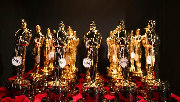 FILE - This March 2, 2014 file photo shows Oscar statues