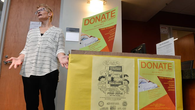 Beth Knutson-Kolodzne, associate director of civic engagement, student organizations and Greek life, talks about the Donate, Don't Ditch! program as she stands next to a donation station in St. Cloud State University's Atwood Memorial Center. There are boxes at each residence hall as well to collect unwanted small appliances, school supplies, clothing, food, household items, and toiletries instead of throwing them out.