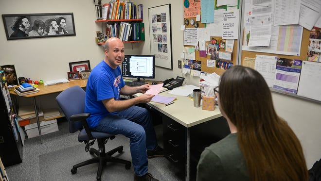 Guidance Counselor Rick Larson talks with graduating senior Hailey Kessel about her college plans in his office Friday, May 6, at Apollo High School. School counselors are facing changing and expanding roles as well as a greater need for more counselors, especially in Minnesota. Minnesota has a high ratio of students to available counselors when compared with other states.