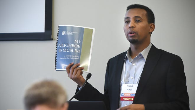 Yusuf Abdi, refugee service program director for Lutheran Social Service of MN, speaks before a panel discussion during the 54th Annual Winter Institute Thursday, Feb. 11, 2016, at St. Cloud State University.