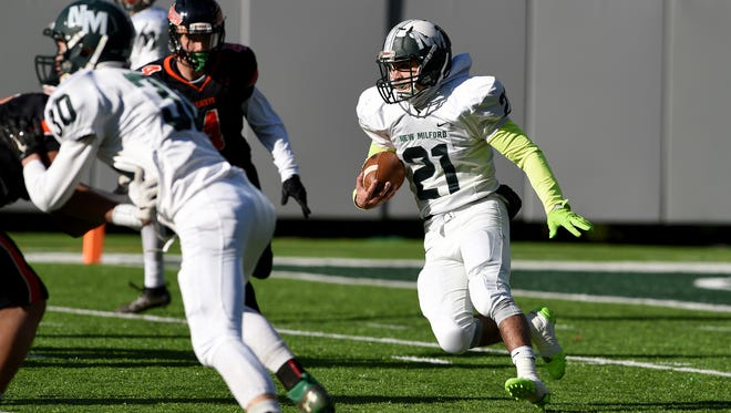 Christian Correa #21 of New Milford rushes the ball against Hasbrouck Heights. Correa had 16 carries for 154 yards in the first half of North 1, Group 1 state championship game against Hasbrouck Heights at MetLife Stadium on Sunday, December 4, 2016. Heights won the game 30-12.