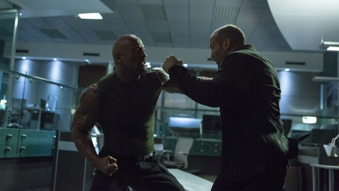 Dwayne Johnson, left, and Jason Statham in a scene from 'Furious 7.'