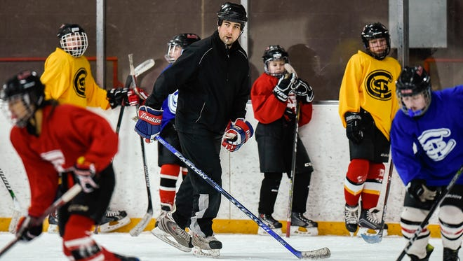 St. Cloud U12 girls hockey team coach Jared Smith watches practice Friday, Jan. 12, at the Herb Brooks National Hockey Center.