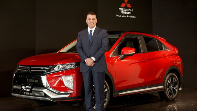 Fred Diaz, with an Eclipse Cross, will take over as president and CEO of Mitsubishi Motors North America April 1, 2018. Diaz previously led Ram Trucks, Nissan's north American truck and commercial business, and worked on Mitsubishi's global sales and marketing.