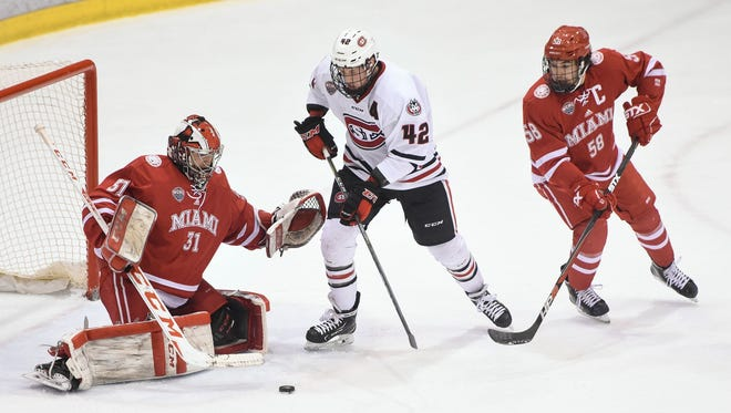 St. Cloud State's Blake Winiecki tries to get a shot off on Miami goaltender Ryan Larkin during the first period of the March 11 game at the Herb Brooks National Hockey Center in St. Cloud. Winiecki recently completed his eligibility for the Huskies and signed a pro deal with the Florida Everblades of the ECHL.