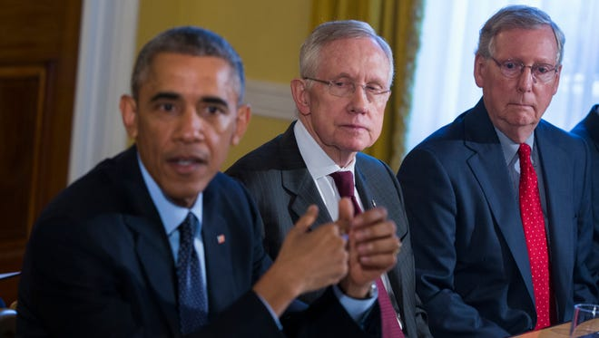 President Obama with Senate Democratic leader Harry Reid, middle, and Senate Republican leader Mitch McConnell.