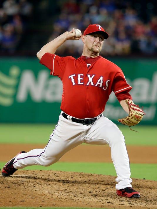 Texas Rangers relief pitcher Austin Bibens-Dirkx throws to the Chicago White Sox during the fifth inning of a baseball game, Thursday, Aug. 17, 2017, in Arlington, Texas. (AP Photo/Tony Gutierrez)