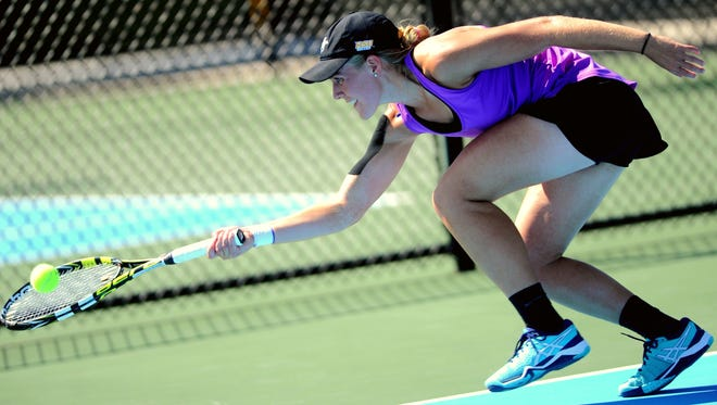 HSU's Shayne Cook runs down a shot by McMurry's Chloe Patterson during their singles match. Patterson won the match 6-2, 7-6 (7-3). HSU beat the War Hawks 5-4 on Tuesday, April 12, 2017 at HSU's Streich Tennis Center.