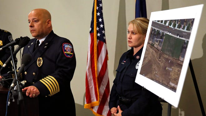 Ted Poszywak, left, chief of the Frederick-Firestone fire department, and public information officer Summer Campos, right, take questions from members of the media  during a news conference, while standing next to a picture of the location where an unrefined gas leak explosion killed two people inside their home in Firestone, Colo., Tuesday, May 2, 2017. Poszywak said that an investigation has revealed that the April 17 explosion was caused by unrefined natural gas that was leaking from a small abandoned pipeline from a nearby well owned by Anadarko Petroleum.