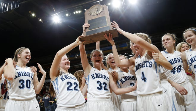 Unity Christian players celebrate their 2A state title win over North Linn Friday, March 6, 2015 at Girls State Basketball Tournament at Wells Fargo Arena in Des Moines.
