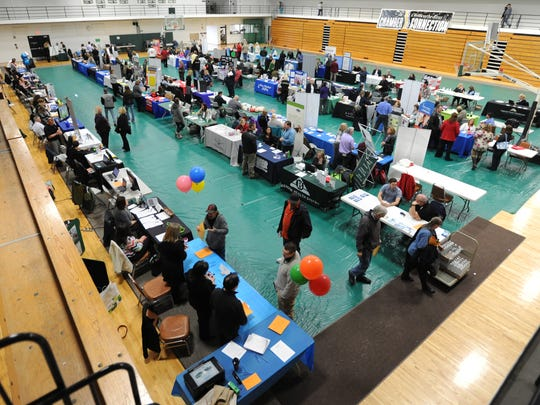 Dozens of companies set up booths to talk to job seekers during a job expo Thursday at Ohio University Chillicothe.
