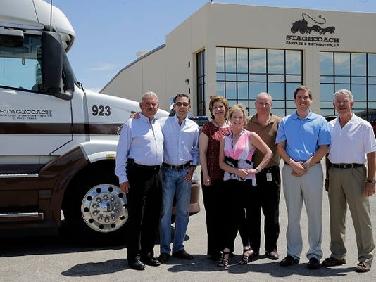Dieter McLaughlin, left, and Scott McLaughlin, right, owners of Stagecoach Cartage & Distribution, and employees, left to right, Jennie Valenzuela, Jeanene Payen, Dale Zeitier, Marco Valles and Wayne Porter stand at the trucking and logistics company's headquarters at 7167 Chino Drive in East El Paso.