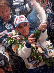 Arie Luyendyk sprays champagne after winning the Indy 500 for the second time at the Indianapolis Motor Speedway on May 27, 1997.
