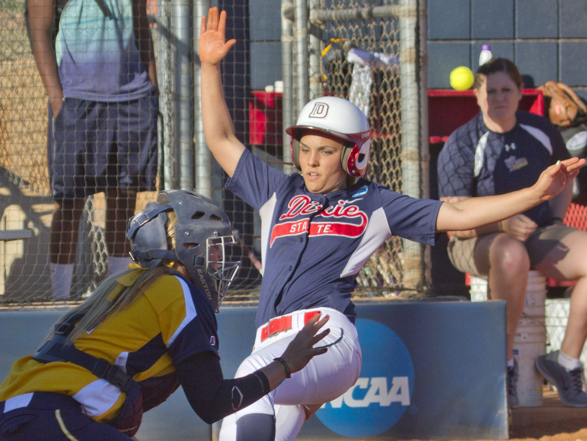 Dixie State third base Sheila Gelter slides into home plate to score against Montana State Billings on Feb. 18.