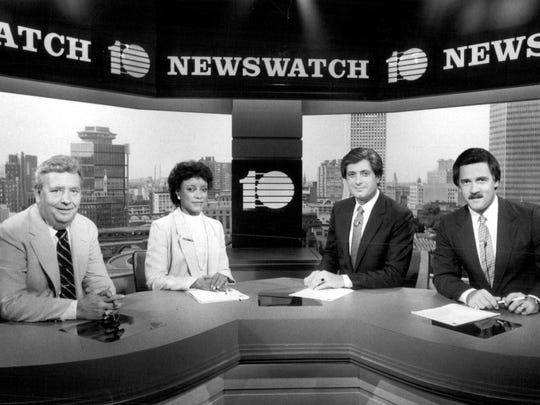 John Hambleton (weather), Janet Lomax (co-anchor), Gabe Dalmath (co-anchor) and Rich Funke (sports) on set at WHEC-TV.