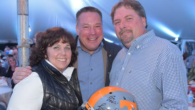 Julie Blalock, coach Butch Jones and Richard McFall at the 2017 Friends of the Smokies Greenbrier Barn Party, which raised funds for the Great Smoky Mountains National Park.